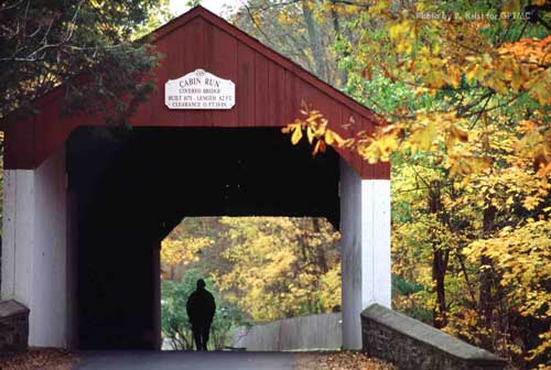 Located in Plumstead Township, Bucks County, this covered bridge, built in 1871, crosses the Cabin Run Creek. Of the 36 covered bridges originally built in Bucks County, only 11 remain.